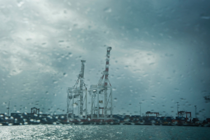 Painterly port pic of cranes in the rain by Roel Loopers