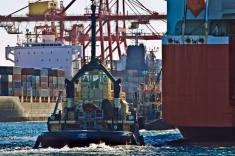 tug boats and container vessels in fremantle port, western australia, australia
